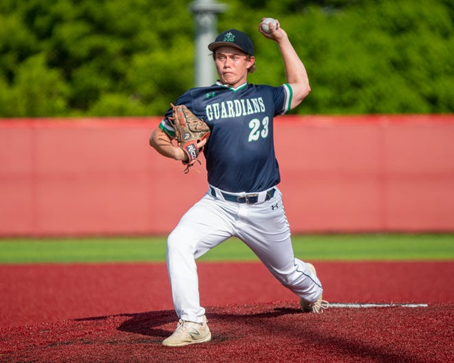 St. Michael the Archangel Catholic pitcher Ian McVey throws to an Adrian batter in the Class 3 District 14 championship game Tuesday at Raytown South High School. McVey allowed just two runs on four hits in six innings but the Guardians fell 2-1.