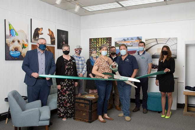 Celebrating the new location of Greg West Photography is ,back row, Ian Oneail, First Seacoast Bank; Margaret Joyce, Dover Chamber president; Michael Mengers, UNH Professional Development & Training; Melissa Launder, GDCC; Kameron Towle, GDCC; Morgan Faustino, GDCC; Melissa Lesniak, Keller Williams Coastal Realty; and  front row, Delise and Greg West of Greg West Photography.