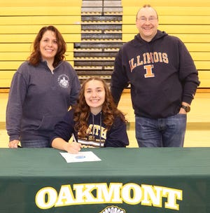 Oakmont senior Sara Buszkiewicz, pictured with her parents Lori and Jim Buszkiewicz at a recent signing ceremony at the Oakmont gym, will continue her education and her athletic career at Smith College in the fall.