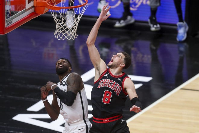 Chicago Bulls guard Zach LaVine (8) yells while going up for basket against Brooklyn Nets forward Jeff Green (8) during the fourth quarter of a game at the United Center in Chicago on May 11, 2021.