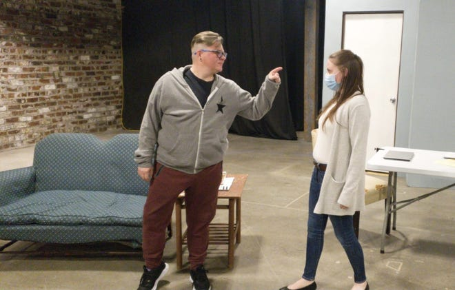 """Samuel Carrington, left, as Arthur, and Courtney Howard, as Paige, rehearse a scene in """"Fountainville,"""" a one-act play by Knox College student Veronica Langley produced by Prairie Players Civic Theatre."""