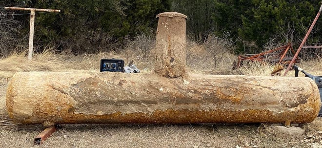 An old butane tank that was buried back in the 1940s at the Gosdin home on Highway 144 some two miles west of Glen Rose, was recently dug up and repurposed.