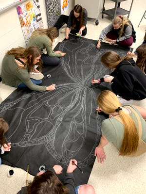 Jonesville High School students work on the FLY project.
