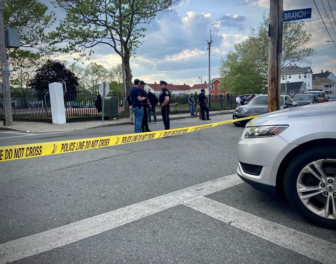 In this photo from May 18, Fall River police investigating a triple shooting near Griffin Park that left two dead and one injured.