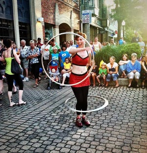 A hula-hooper performs during Holland's annual Street Performer Series. The event is currently accepting applicants for the 2021 series.