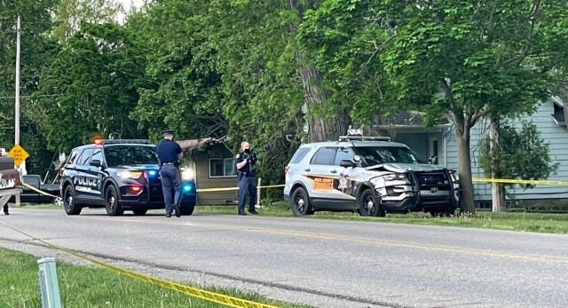 Police officers on the scene of an incident involving an Ionia County Sheriff's Office cruiser Wednesday, May 19, in Mulliken.