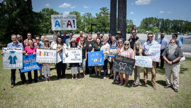 Coastal Carolina Community College recently recognized the Class of 2021 with its 56th commencement held as a drive-through ceremony at the college campus. Pictured are some of the family and friends that supported the graduates as they picked up their diplomas.