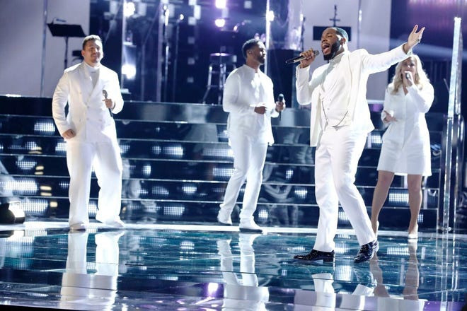 """Amid backing vocalists, Peoria High School graduate Victor Solomon performs this week on """"The Voice."""" Solomon advanced to the competition finals, which are to be aired next week on NBC-TV."""