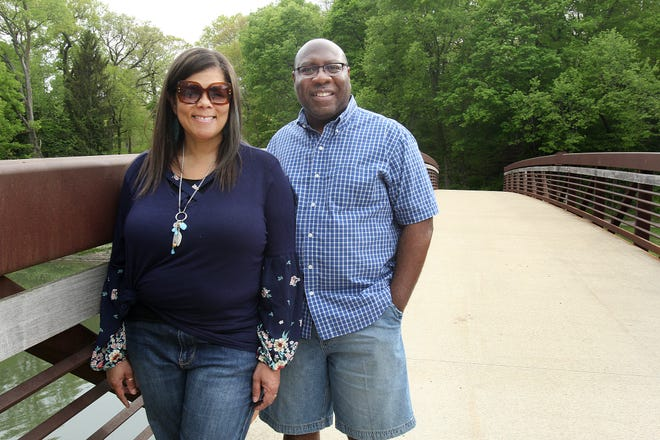 Denise McIlwain, left, and her husband, Kelvin, stand on the footbridge over the Yellow Creek on Friday, May 14, 2021, at Krape Park in Freeport. This week, the couple each started new roles on elected boards.