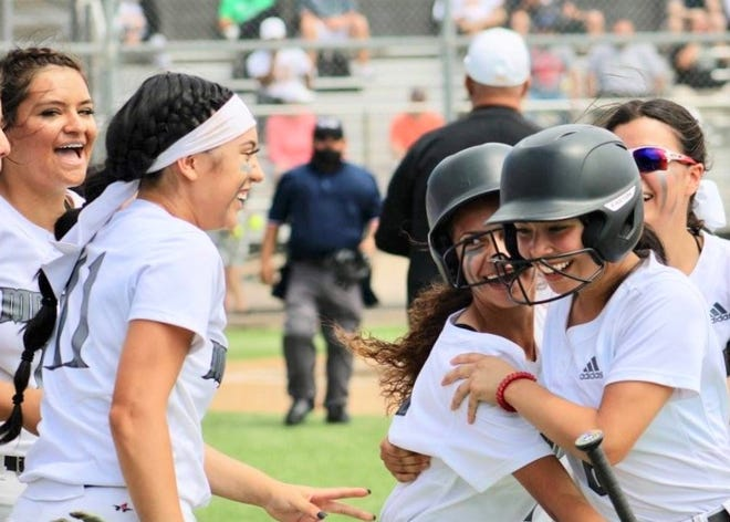 The Seminole Maidens celebrate a run during a Region I-4A quarterfinal game against Snyder on Saturday at Odessa Permian High School.