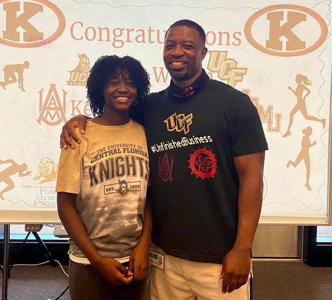 Kathleen sprinter I'Asia Wilson is with Kathleen track coach Ledarius Haggins after she signed with UCF.