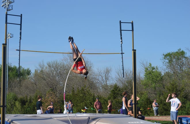 Shown is Lansing junior Reece Baker competing in the pole vault event for the track and field team.