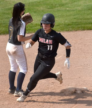 Lauren Schneider of Milan rounds second base for a triple Wednesday as Airport shortstop Katelyn Poe waits for the throw from right field. Schneider went 6-for-7 to lead her team to a 9-3, 3-2 doubleheader sweep.