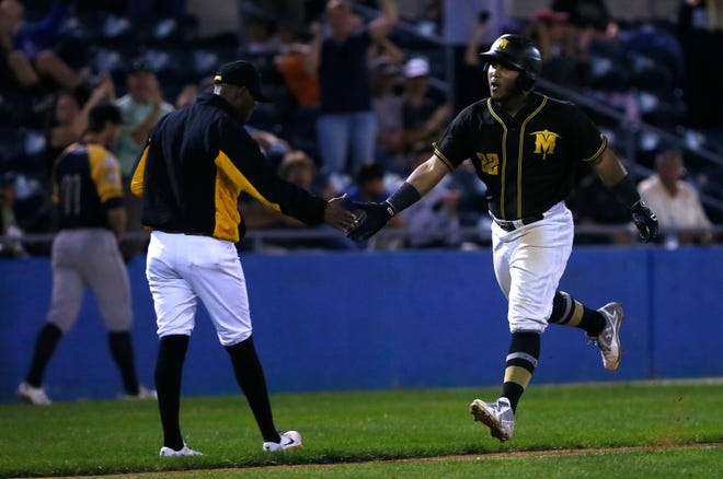 Photo by Jake West / New Jersey Herald - The Miners' Martin Figueroa highfives Bobby Jones as he runs home during the Can-Am League Championship game against the Capitales, Saturday, September 15, 2018, at Skylands Stadium, in Frankford.