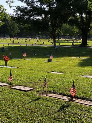 Flags on cemetery markers