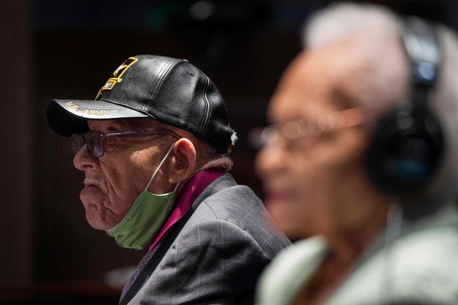 """Hughes Van Ellis(L), a Tulsa Race Massacre survivor and World War II veteran, testifies before the Civil Rights and Civil Liberties Subcommittee hearing on """"Continuing Injustice: The Centennial of the Tulsa-Greenwood Race Massacre"""" on Capitol Hill in Washington, DC on May 19, 2021. (Photo by JIM WATSON / AFP) (Photo by JIM WATSON/AFP via Getty Images) ORG XMIT: 0 ORIG FILE ID: AFP_9AB942.jpg"""