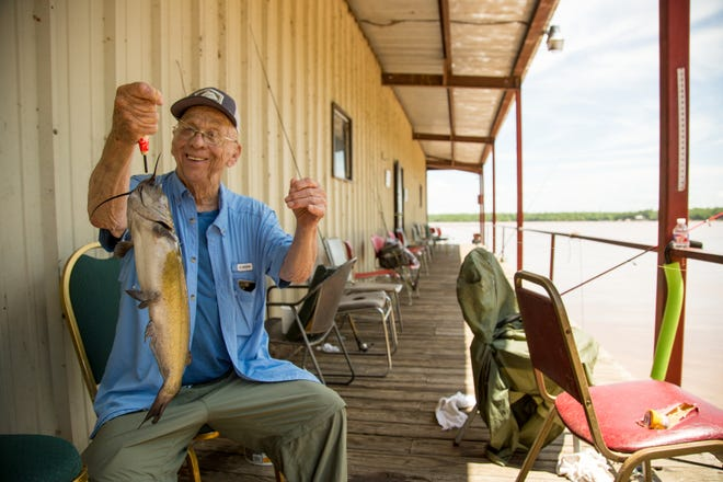 A fisherman shows off his catch at Lake Eufaula.