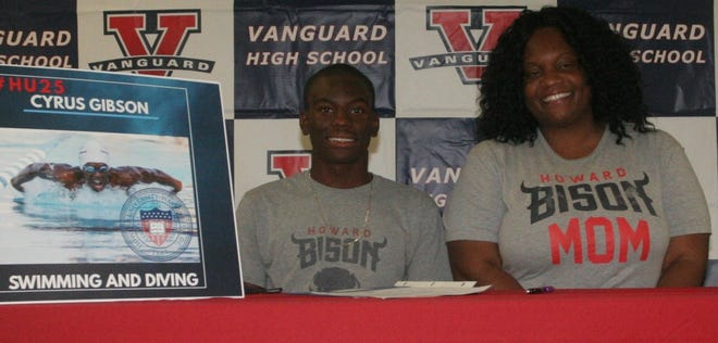 Vanguard senior swimmer Cyrus Gibson signed an academic scholarship with Howard University on Wednesday as mother, Antoinette Davis, looks on. Gibson will compete in swimming and diving for the Bison and is the first African-American male from Marion County to swim at a Division I school.