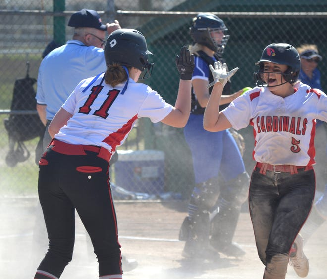 Johannesburg-Lewiston's Autumn Vermilya (5) gets congratulated by teammate Jamie Burke (11) after scoring a run during game one of a Ski Valley Conference doubleheader at Inland Lakes on Monday.