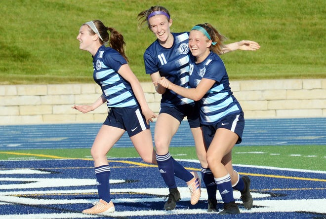 Petoskey senior Autumn Naturkas (far right) celebrates after scoring the first goal against TC Central with teammates Dana Cole (middle) and Lauren Cole (left).