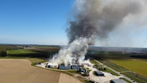 Heavy smoke is seen rising from the Kitchen Farms complex in Antrim County Monday. A fire heavily damaged the potato farm and the cause remains under investigation. There were no injuries reported.