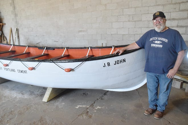 Lon Calloway of Indian River has spent the past four weeks restoring the lifeboat from the former J.B. John, which in November was swept off its resting spot on the Petoskey waterfront pier and later discovered in a marina slip.