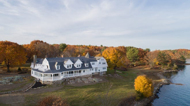 This aerial shot of Creek Farm shows the property along Sagamore Creek that includes the newly restored Carey Cottage.