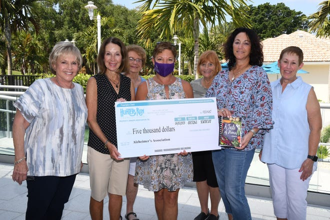 Hunters Run Cookbook Committee members present a check for $5,000 to the Alzheimer's Association. From left: Lynn Borislow; Heidi Rubin, committee co-chair; Barbara Levitt; Tracey Paige, executive director, Alzheimer's Association Southeast Florida Chapter; Stephanie Kreiner; Rebecca Barth, committee co-chair; and Debbie Levine.