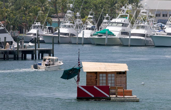 A floating structure sits north of Peanut Island near Sailfish Marina in this 2015 file photo. Palm Beach County commissioners are likely to approve an update to rules that ban floating structures from anchoring in county waters.