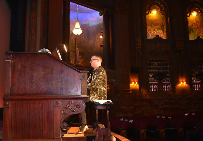 """Tri-Cities Pride, Inc. President Mikey Fuller plays the """"Mighty Wurlitzer"""" at the Byrd Theatre in Richmond, Va. on May 8, 2021."""