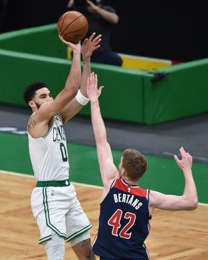 May 18, 2021; Boston, Massachusetts, USA;  Boston Celtics forward Jayson Tatum (0) shoots the ball over Washington Wizards forward Davis Bertans (42) during the first half at TD Garden. Mandatory Credit: Bob DeChiara-USA TODAY Sports
