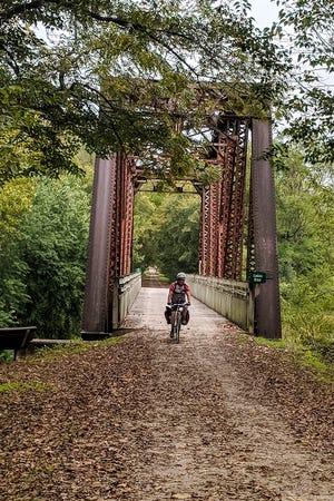 Cyclist Bill Severson crossing the Lamine River Bridge on the Katy Trail in Cooper County, Missouri.