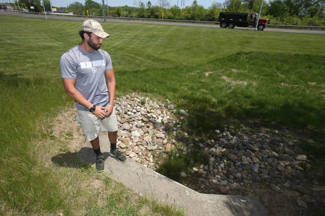 Luke Brittain pauses at the site of the accident at Kent State University's Stark campus where the stand-up lawn mower he was using toppled over, severing his fingers.