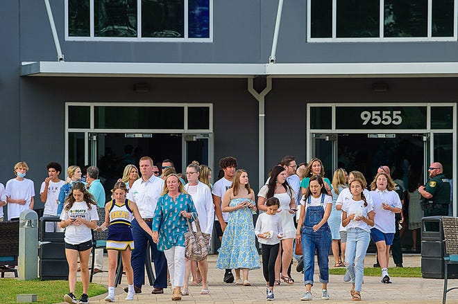 People walk from a memorial service to remember Tristyn Bailey, 13, held at the Celebration Church in Jacksonville on Tuesday, May 18, 2021.