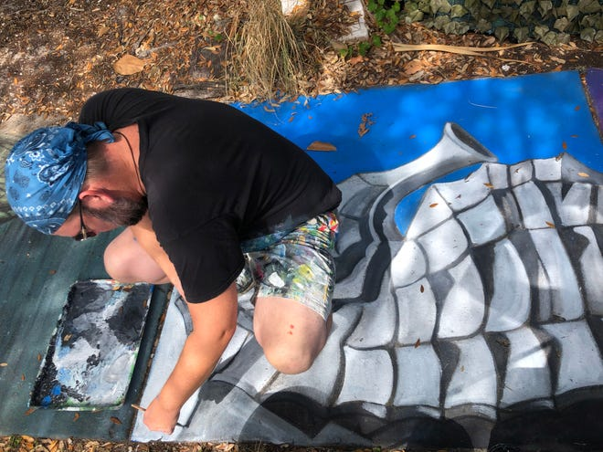 """Sarasota-based artist Truman Adams, works on an image of a Seahorse from the Lido Beach Casino as part of the """"Chalk Festival Avenue of Art,"""" which will celebrate Sarasota County's centennial."""