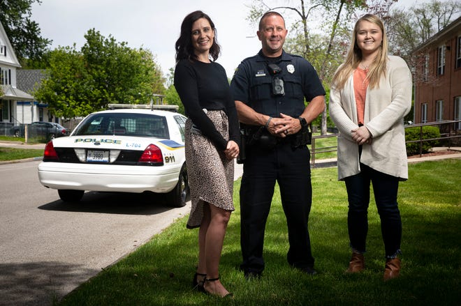 Sara Anderson, left, manager for Memorial Behavioral Health complex care team and care coordination program, Springfield Police Officer Steve Termine and Jamie Riedle, community outreach and engagement specialist for Memorial Behavioral Health, in Springfield, Ill., Friday, May 14, 2021. The Springfield Police Department partners with Memorial Behavioral Health to get mental health resources into the community by having a police officer team up with a mental health counselor to respond to calls that involve a subject that needs mental health services.