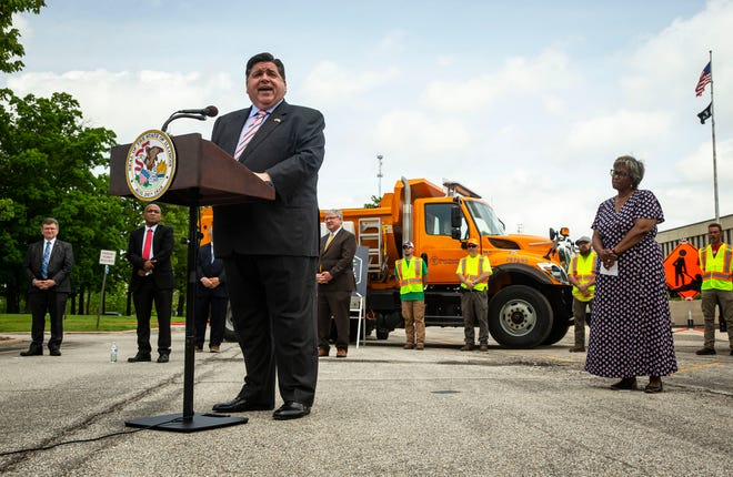 Gov. JB Pritzker announces the $20.7 billion Highway Improvement Program to improve Illinois' roads and bridges over the next six years during a press conference at the Illinois Department of Transportation in Springfield on Wednesday.