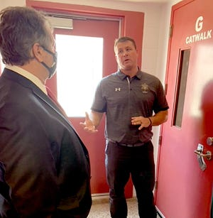 Commissioner Dan Czajkowski and other members of the St. Joseph County Board of Commissioners listen to Sheriff Mark Lillywhite in the maximum-security jail area of the sheriff's department. Commissioners toured the facility Tuesday.