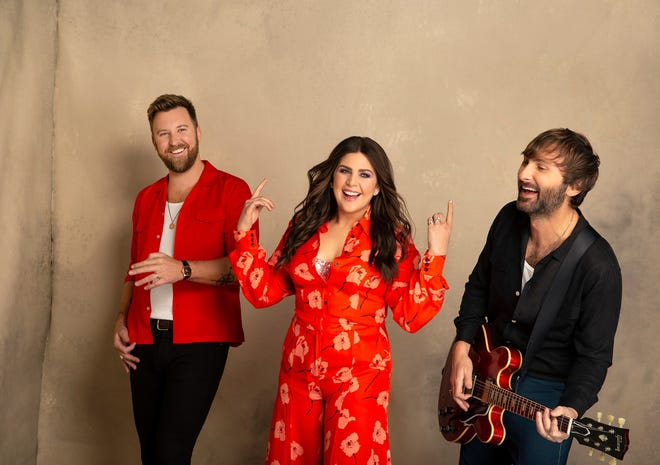 From left, Charles Kelley, Hillary Scott and Dave Haywood of country band Lady A, which will play Riverfront Park Amphitheater in Wilmington on Sept. 30.