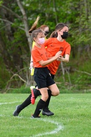 Kennedy Frawley and Hadley Goyette celebrate Kennedy's late-game goal.