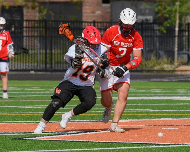 Middleboro's Kyle Jones and New Bedford's Anderson Medrano battle for ball control during a face off last Monday at Middleboro High School. After an 0-3 start, and a couple of close losses, Middleboro notched their first win of the season, 11-0, over the Whalers.