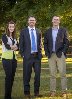 Lucas Bruns, right, and his Northwestern Mutual team.