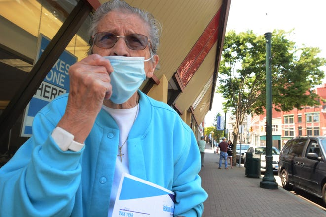 Bea Chandler, 91, of Norwich wears her mask in downtown Norwich in May on the first day Connecticut residents do not have to wear them outside.