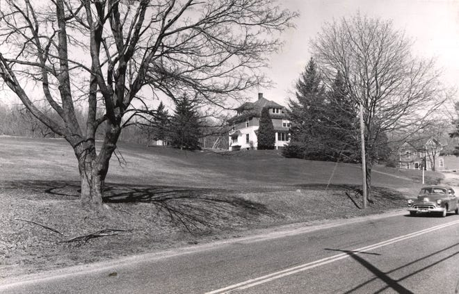 The Worcester Diocese bought 11 acres on Grove Street to build Marian High. The house in this 1961 photo, once used by the school custodian, remains.