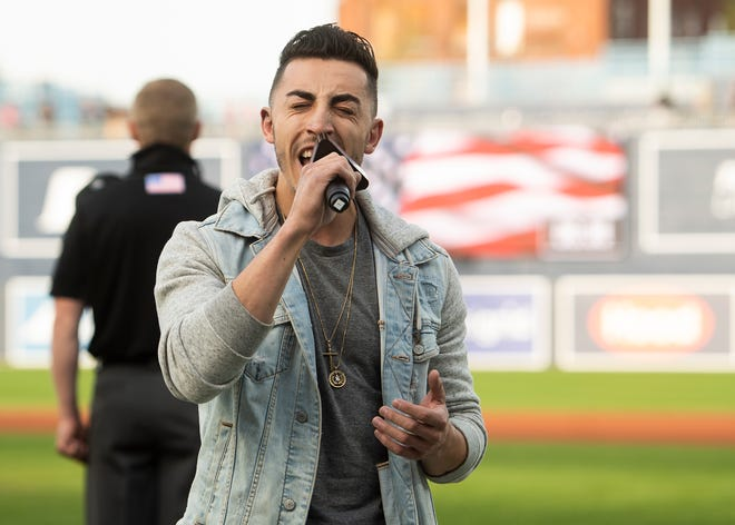 Ricky Duran performs the National Anthem before a recent  WooSox game.