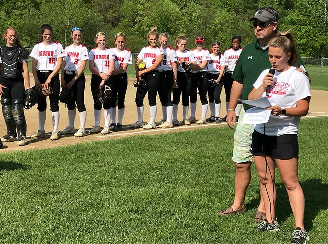 Hudson High softball coach Laura Bowen delivers an emotional speech Tuesday, honoring the late Russ Davis during a special ceremony for the longtime Hudson and Oakmont soccer and softball coach, who died in March. Standing alongside Bowen is Oakmont softball coach Randy Jepson.