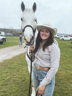 Clear Spring High School student Jenna Bryan is pictured with her horse, Coors.