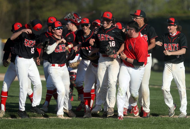South's Logan Hunn (16) celebrates with teammates and coaches after pitching a five-inning no-hitter in an 18-0 win over North on April 23. The Wildcats, who later celebrated an OCC-Capital title, faced Gahanna in a Division I district semifinal May 24.