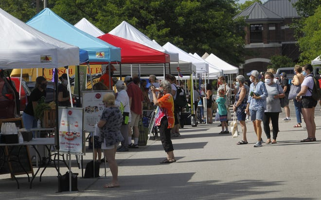 Patrons stroll through the Bexley Farmers Market last year. The market, which opened May 20, runs 4 to 7 p.m. every Thursday through October.