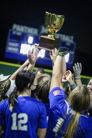 The Lady Panthers lifted another trophy in celebration after advancing into the Regional Semifinals.